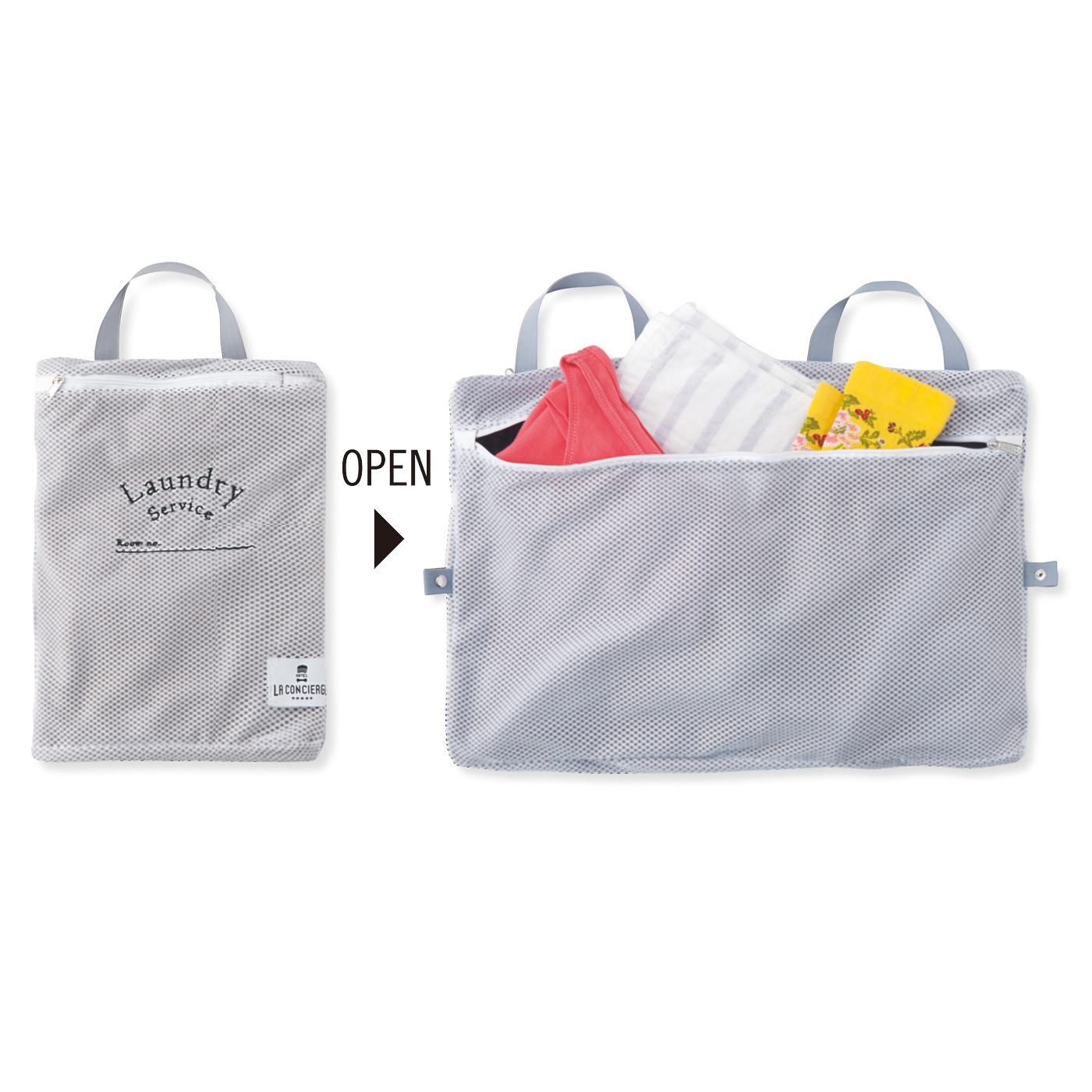 そのまま洗えるランドリーバッグ 分けて収納できるポケット付き。 ■素材/ポリエステルなど ■サイズ/縦約28cm、横約22cm、持ち手の長さ約25cm ※2つ折時 ※洗濯機洗い可