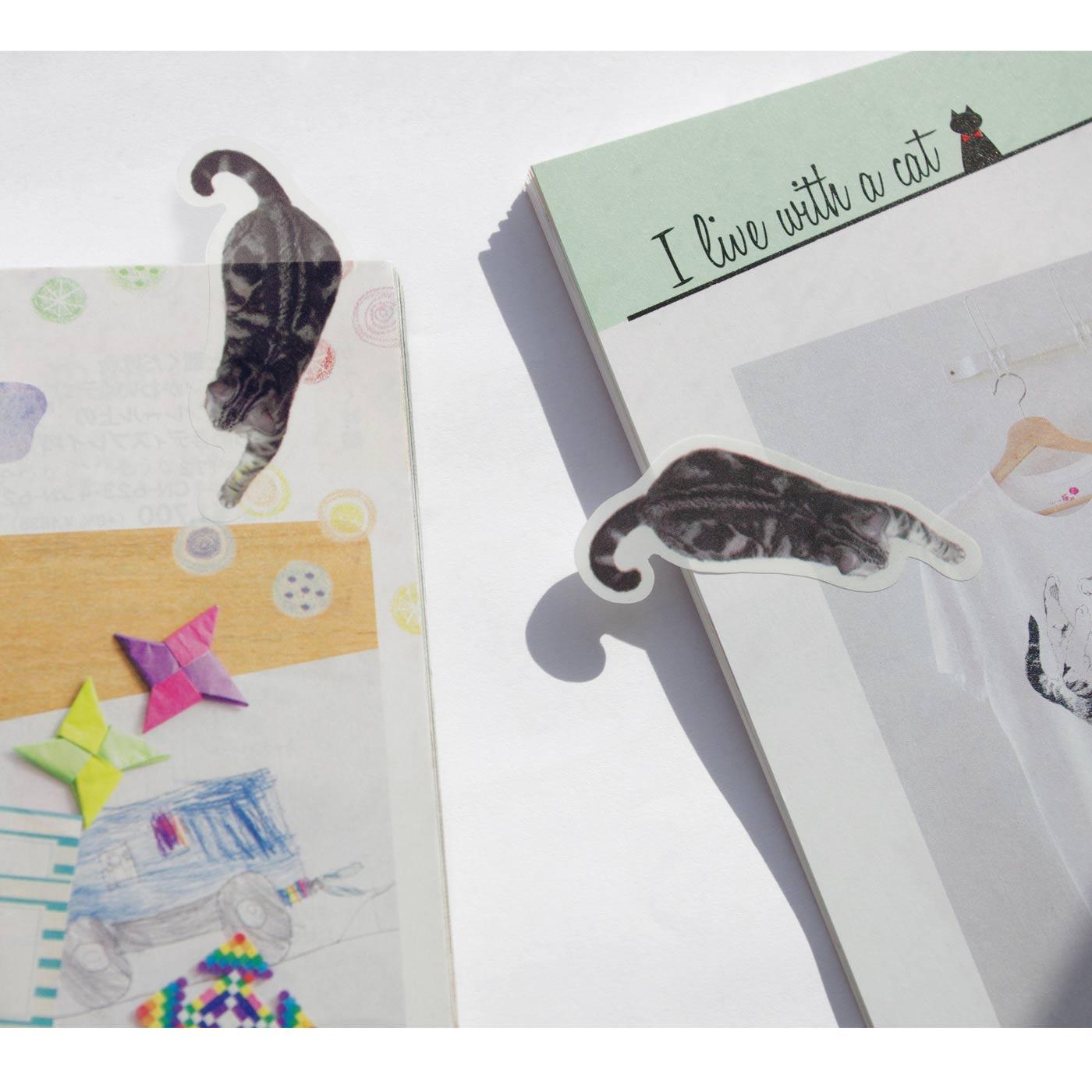 雑誌や本を見ていて「これ欲しい!」となったらこの猫さんを。上から横から、好きな位置から猫さんを飛びつかせちゃいましょう。