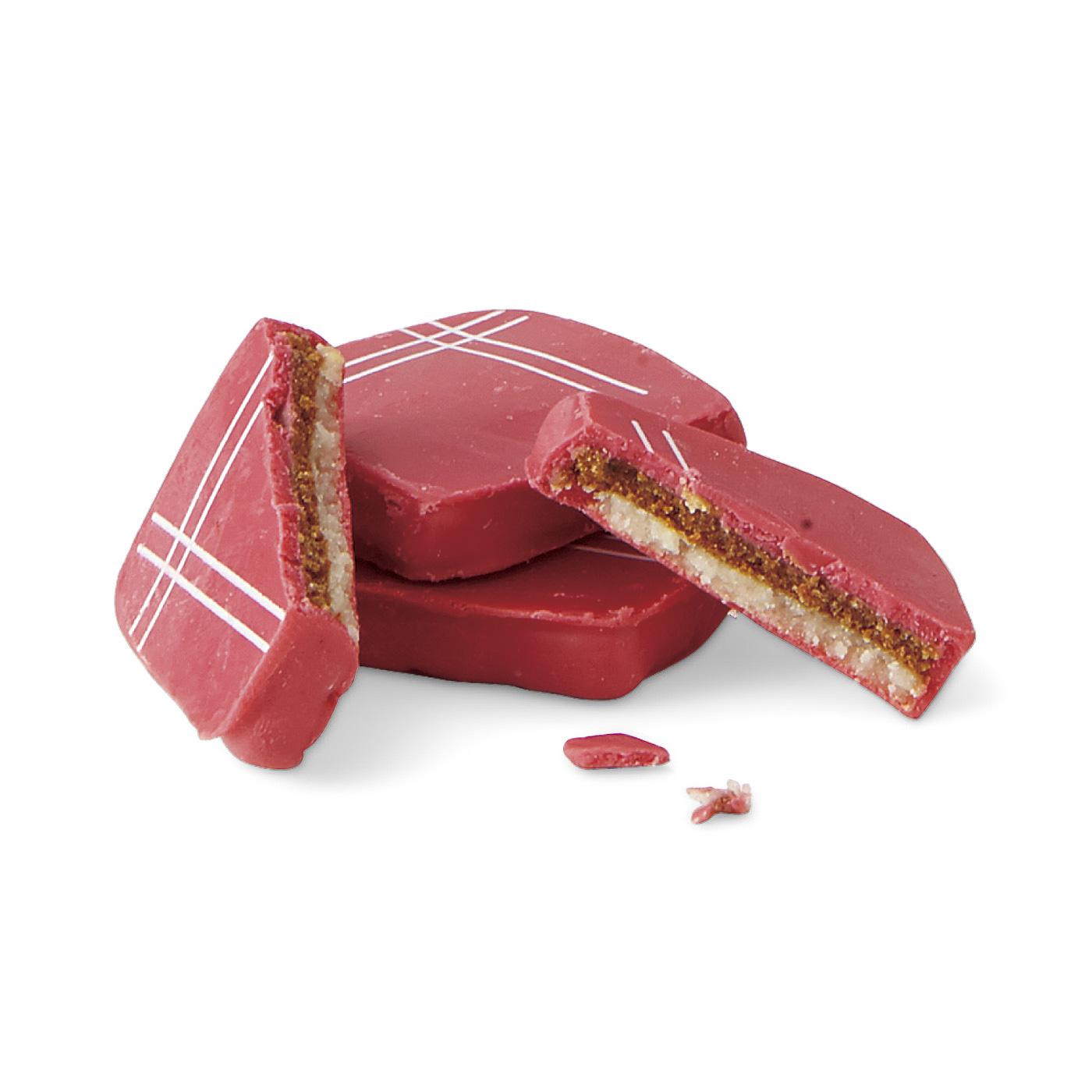 地元の特産品である繊維を使って作られた赤いハンカチがモチーフの赤チョコ。オレンジ風味のアーモンドペーストとプラリネの上品な甘さとさわやかさが新鮮!