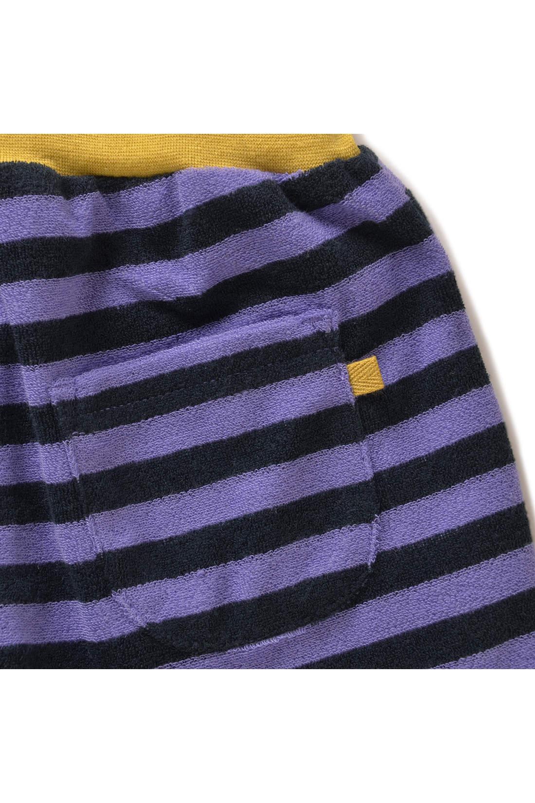 おしりのポケットにはワンポイントのピスネーム付き。