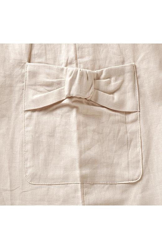 ポケット口はリボンの形。