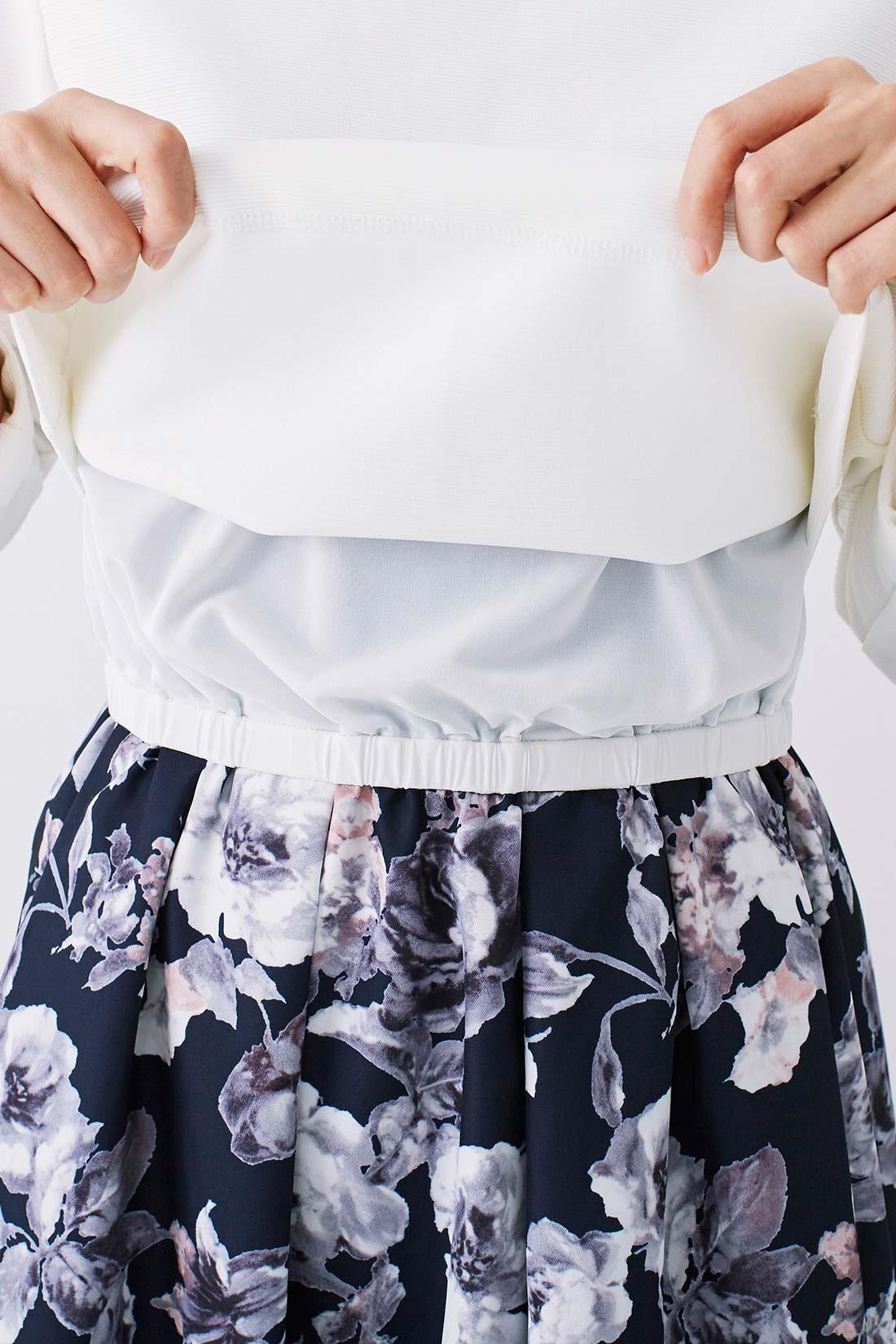 トップス身ごろの裏地とスカートがドッキング。すそがスカートに自然に重なるので、上下コーデに見えて手抜き感もなし!※お届けするカラーとは異なります。
