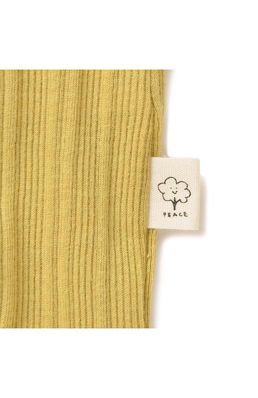 左わきのすそには、綿花をかわいいイラストにしたPBPのネームタグ付き。