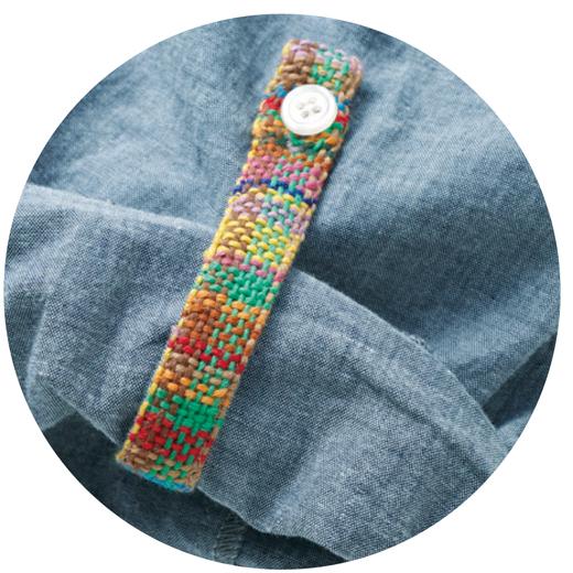 袖口とポケットのさをり織りがアクセント。
