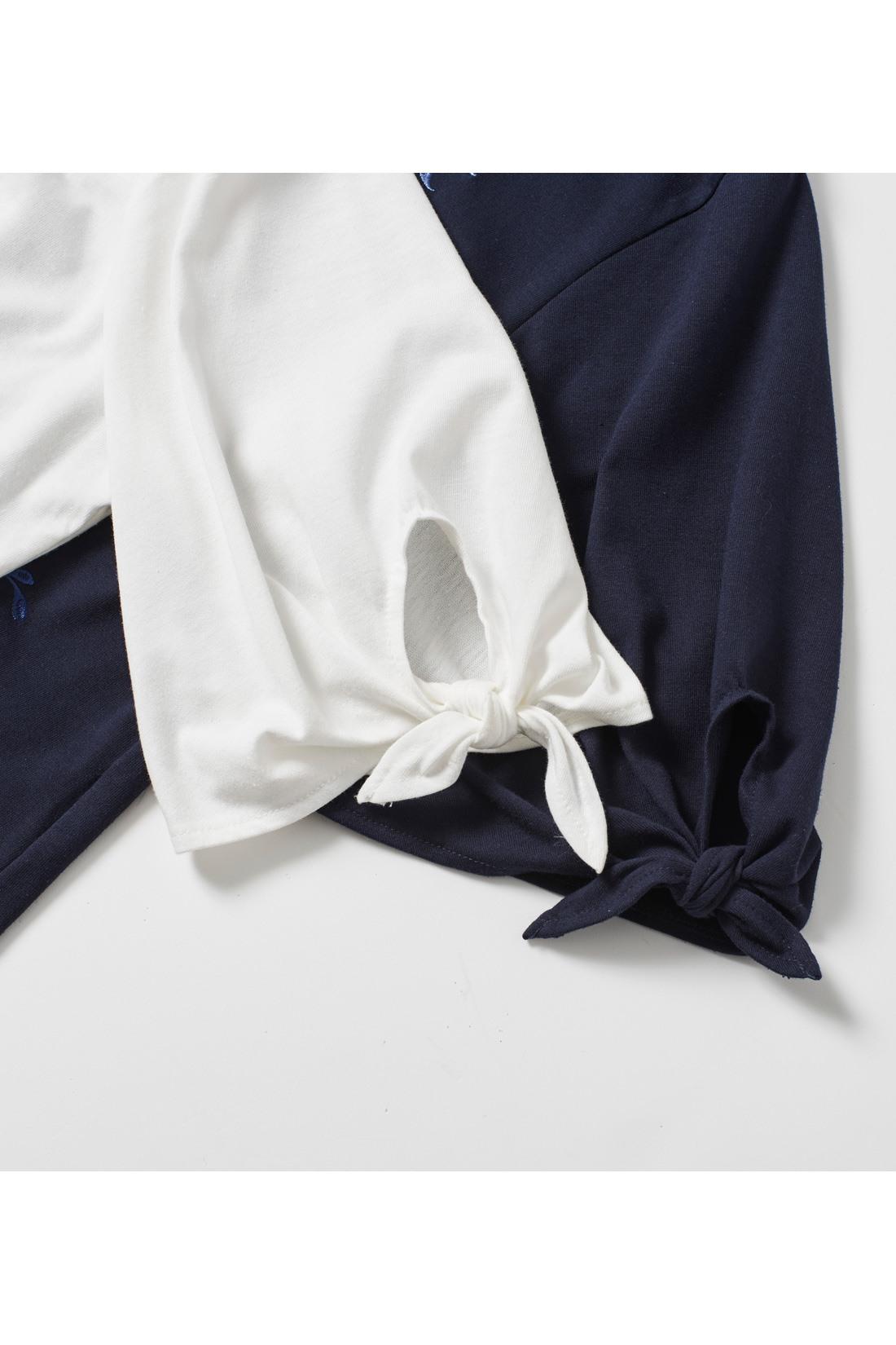 袖口のリボンデザインが旬ポイント。