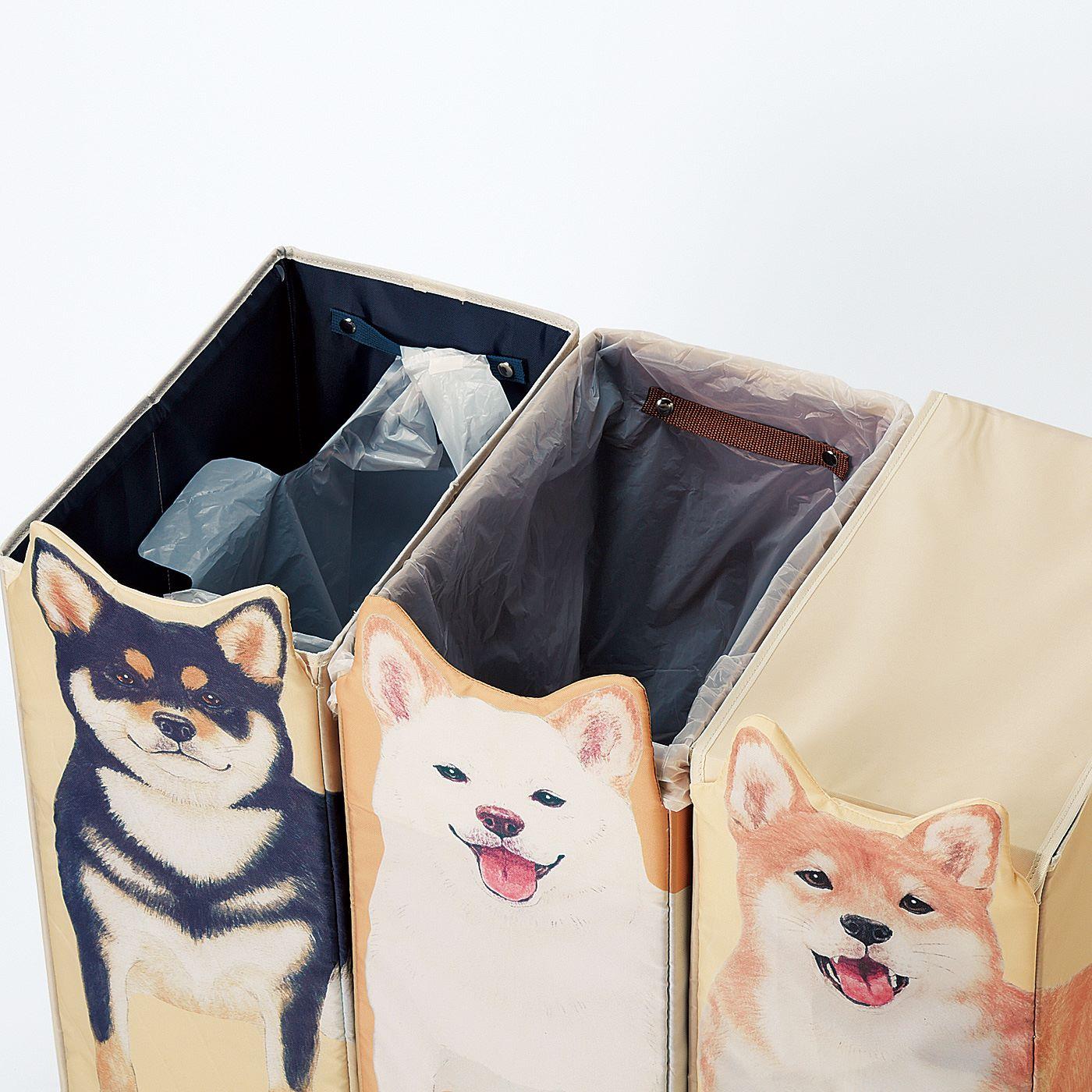 45Lまでのごみ袋や、レジ袋を留められるスナップボタン付き。3匹並べればごみの分別もおまかせ。