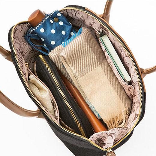 内側にはファスナーポケットと、携帯電話が収まるポケット付き。