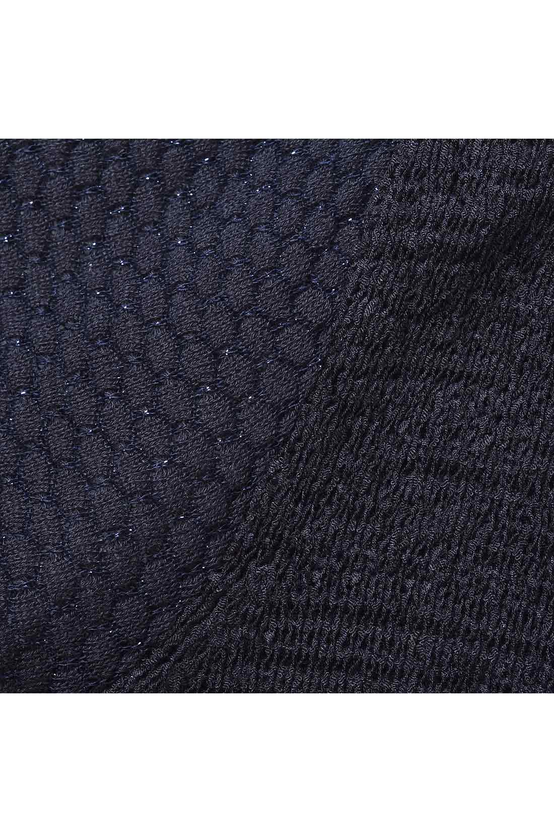 身ごろの部分はメリヤス編み、お袖の部分は模様編みに。