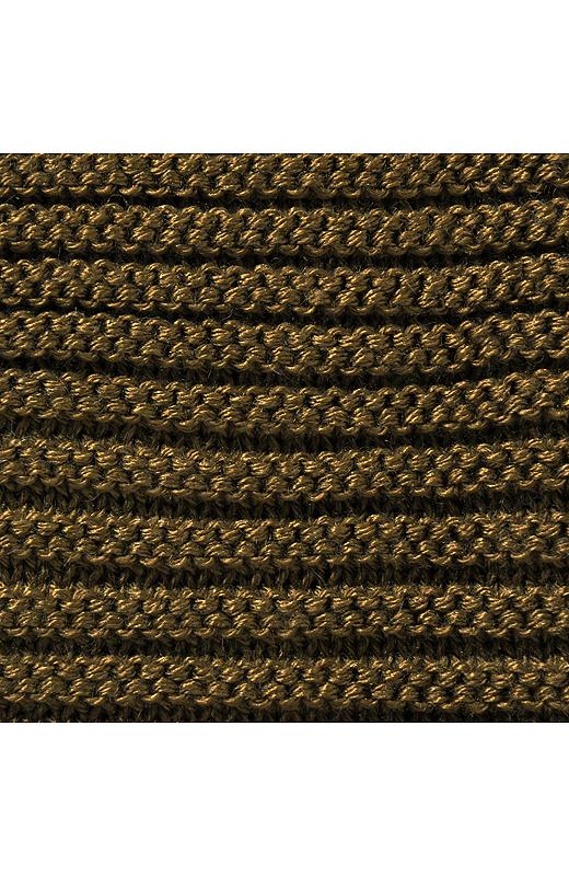 ヒップラインを自然にカムフラージュする変わりガーター編み。