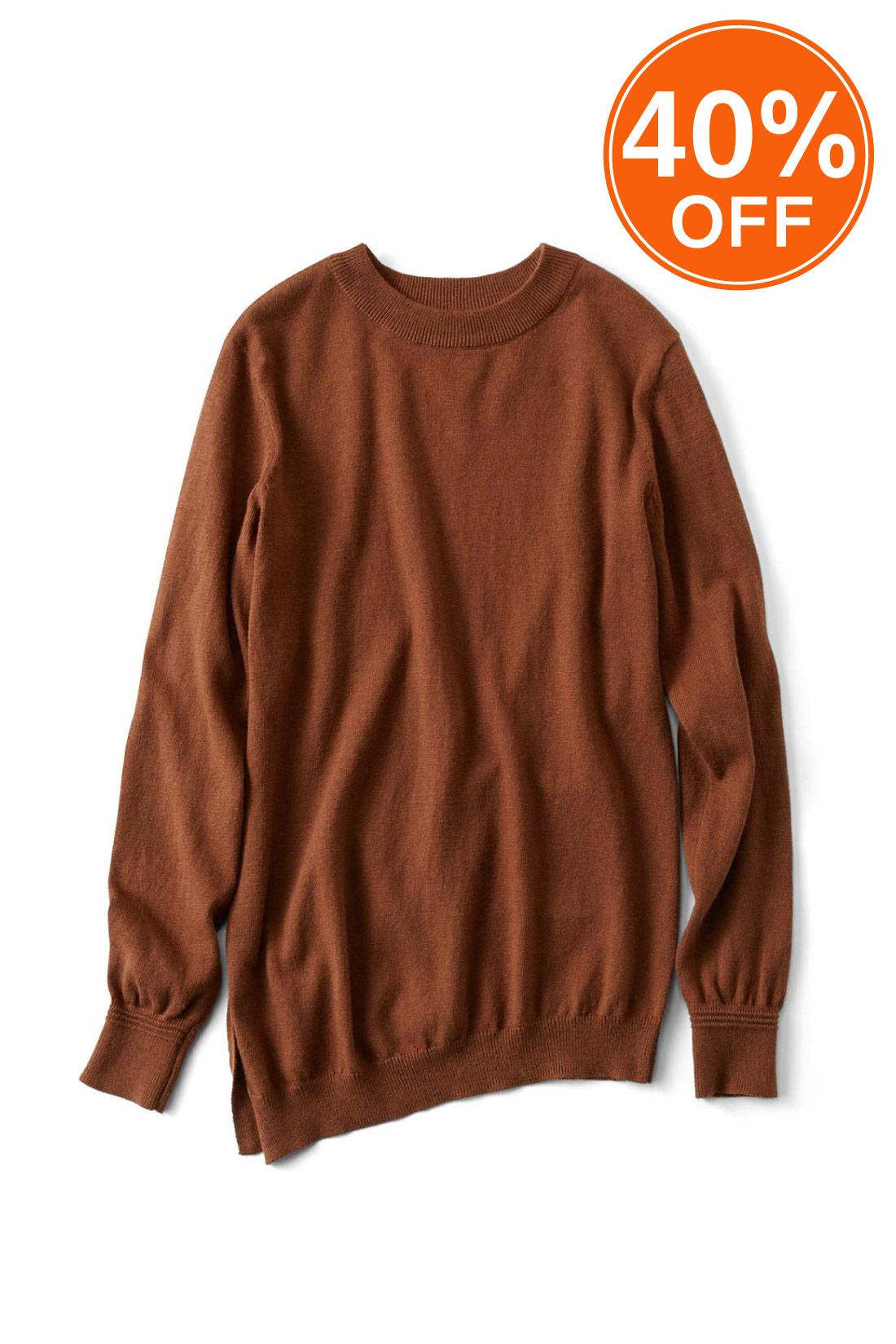 女らしく決まる〈ブラウン〉 袖にはこだわりのタック編みでさりげないアクセント。