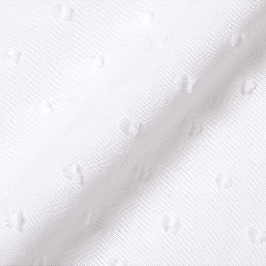 トップスの胸下は、ドット織り柄が素敵な綿100%素材。